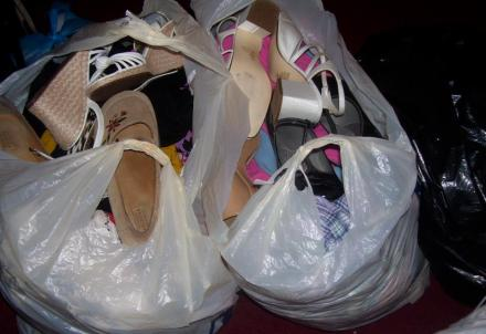 Bags of clothes and shoes that Ms. Charm gave away to non-profits last year.