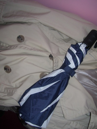 Ms. Charm's umbrella and trench coat. (Photo by Ms. Charm).