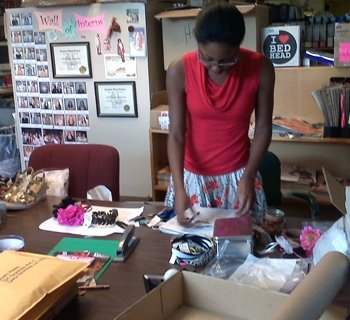 Ms. Charm interning in the fashion closet at Girls Life Magazine circa 2009.